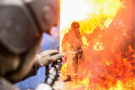 student fighting - Firefighters in simulation training Stock Photo - Premium Royalty-Free, Code: 649-06622763