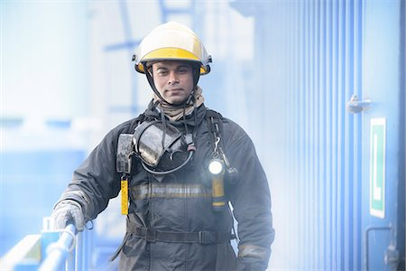 Firefighter standing on platform Stock Photo - Premium Royalty-Free, Code: 649-06622770