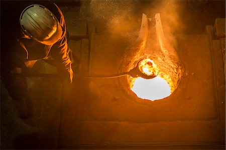 flame - Worker stirring molten metal in foundry Stock Photo - Premium Royalty-Free, Code: 649-06622817