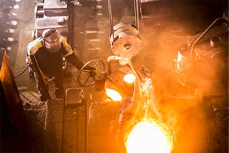 flame - Worker pouring molten metal in foundry Stock Photo - Premium Royalty-Free, Code: 649-06622819