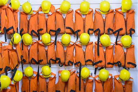 repeating - Safety vests and hard hats on wall Stock Photo - Premium Royalty-Free, Code: 649-06622848