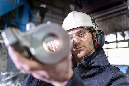 Worker inspecting metal in foundry Stock Photo - Premium Royalty-Free, Code: 649-06622872