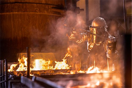 fire - Worker pouring molten metal in factory Stock Photo - Premium Royalty-Free, Code: 649-06622880