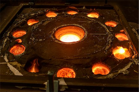 pattern (man made design) - Molten metal in moulds in foundry Stock Photo - Premium Royalty-Free, Code: 649-06622882