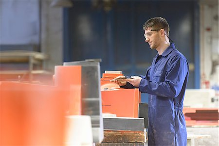 Worker making mould in foundry Stock Photo - Premium Royalty-Free, Code: 649-06622896