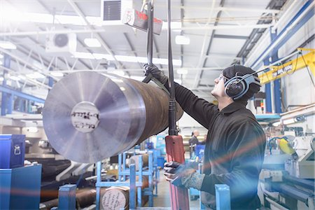 Worker using crane in steel factory Stock Photo - Premium Royalty-Free, Code: 649-06622901