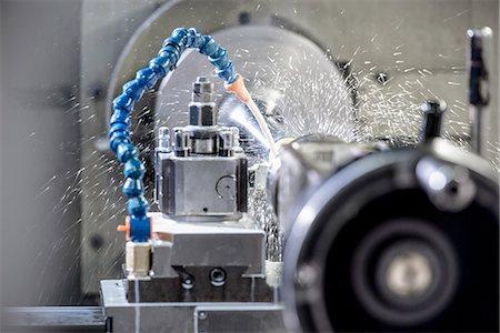 Water spraying on machinery in factory Stock Photo - Premium Royalty-Free, Code: 649-06622934