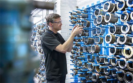 Worker selecting metal coil in factory Stock Photo - Premium Royalty-Free, Code: 649-06622940
