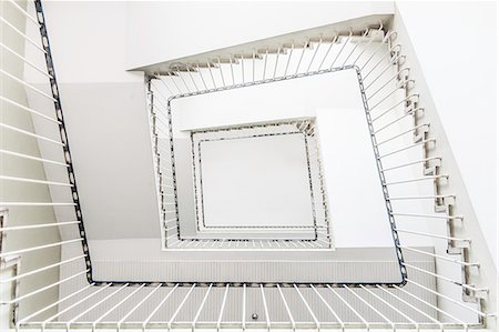 spiral - Square staircase viewed from floor Stock Photo - Premium Royalty-Free, Code: 649-06622990
