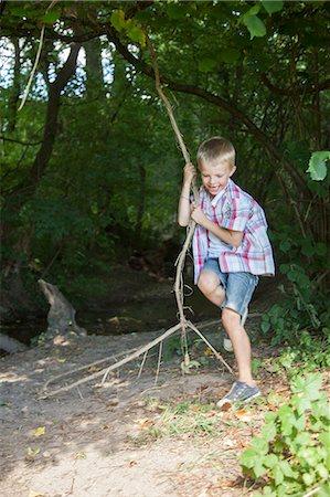 stick - Boy playing on tree swing Stock Photo - Premium Royalty-Free, Code: 649-06623043