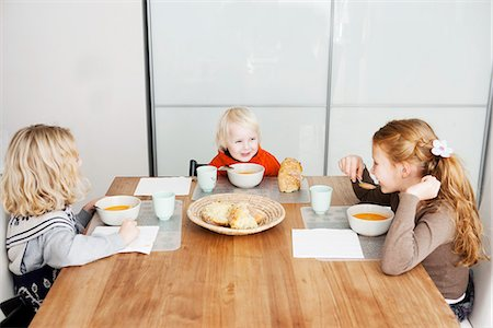family table eating together - Children eating lunch at table Stock Photo - Premium Royalty-Free, Code: 649-06623057