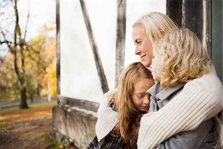 preteen family - Mother and daughters sitting outdoors Stock Photo - Premium Royalty-Free, Code: 649-06623076