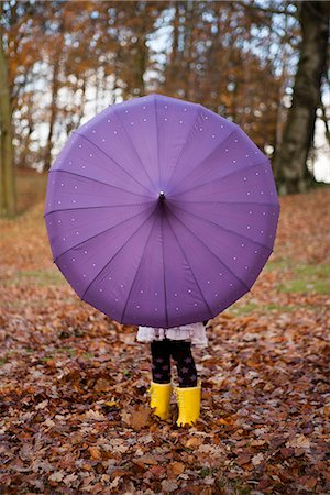 Girl playing with umbrella in park Stock Photo - Premium Royalty-Free, Code: 649-06623087