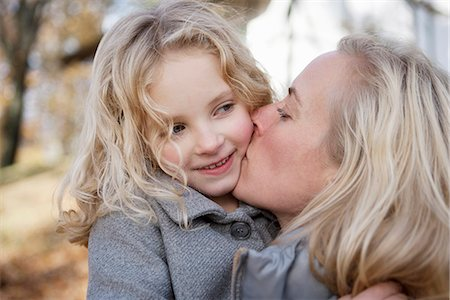 daughter kissing mother - Mother kissing daughter outdoors Stock Photo - Premium Royalty-Free, Code: 649-06623082