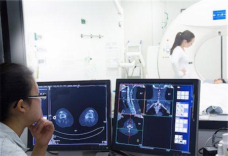 results - Nurse examining x-rays in hospital Stock Photo - Premium Royalty-Free, Code: 649-06623108