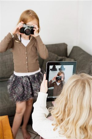 Girls taking pictures of each other Stock Photo - Premium Royalty-Free, Code: 649-06623101