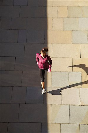 Woman running on city street Stock Photo - Premium Royalty-Free, Code: 649-06716529