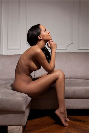 Nude woman sitting on sofa Stock Photo - Premium Royalty-Free, Code: 649-06716657