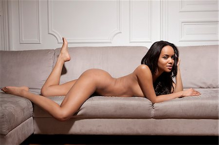 Nude woman laying on sofa Stock Photo - Premium Royalty-Free, Code: 649-06716658