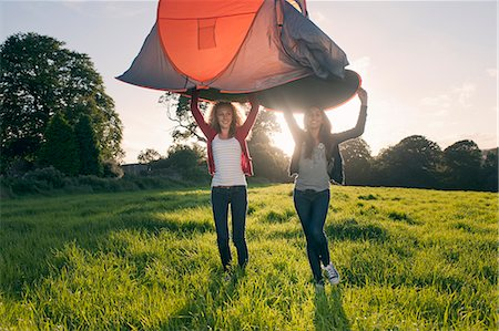 Teenage girls pitching tent in field Stock Photo - Premium Royalty-Free, Code: 649-06716858