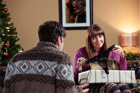 Couple opening Christmas presents Stock Photo - Premium Royalty-Free, Code: 649-06716866