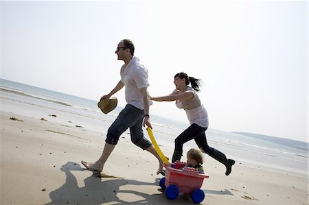 families playing on the beach - Family playing together on beach Stock Photo - Premium Royalty-Free, Code: 649-06716891