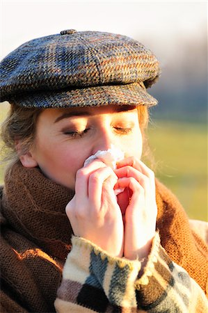 people coughing or sneezing - Woman blowing her nose at sunrise Stock Photo - Premium Royalty-Free, Code: 649-06716916