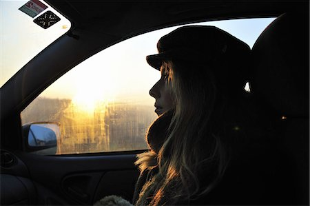 Woman riding in car at sunrise Stock Photo - Premium Royalty-Free, Code: 649-06716929