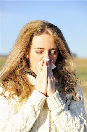 people coughing or sneezing - Woman blowing her nose outdoors Stock Photo - Premium Royalty-Free, Code: 649-06716935