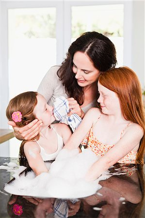 preteen girls faces photo - Mother wiping daughters face in kitchen Stock Photo - Premium Royalty-Free, Code: 649-06716984