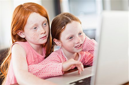 red hair preteen girl - Girls using laptop together Stock Photo - Premium Royalty-Free, Code: 649-06716996