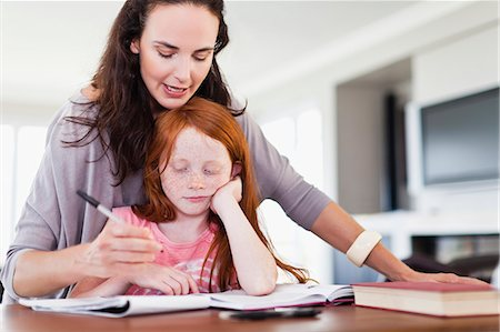 Mother helping daughter with homework Stock Photo - Premium Royalty-Free, Code: 649-06716997