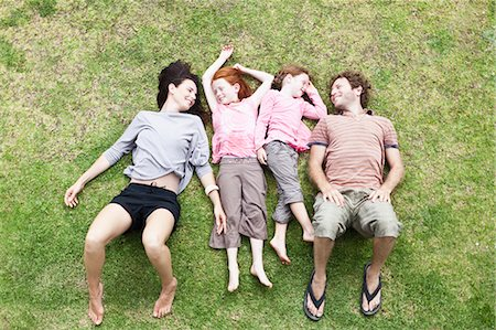 Family laying in grass together Stock Photo - Premium Royalty-Free, Code: 649-06717008