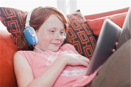 red hair preteen girl - Girl in headphones using tablet computer Stock Photo - Premium Royalty-Free, Code: 649-06717010