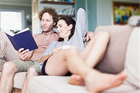 Couple relaxing together on sofa Stock Photo - Premium Royalty-Free, Code: 649-06717023