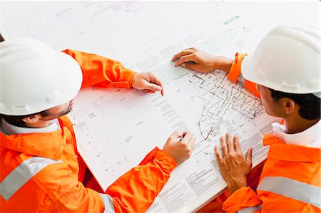 sitting - Businessmen reading blueprints Stock Photo - Premium Royalty-Free, Code: 649-06717090