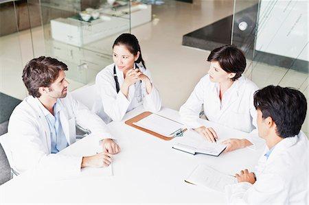 partnership - Doctors talking in meeting Stock Photo - Premium Royalty-Free, Code: 649-06717113