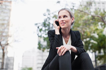 Businesswoman talking on cell phone Stock Photo - Premium Royalty-Free, Code: 649-06717148