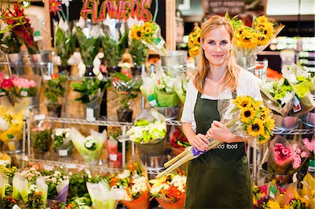 florist - Grocer working in florist section Stock Photo - Premium Royalty-Free, Code: 649-06717200