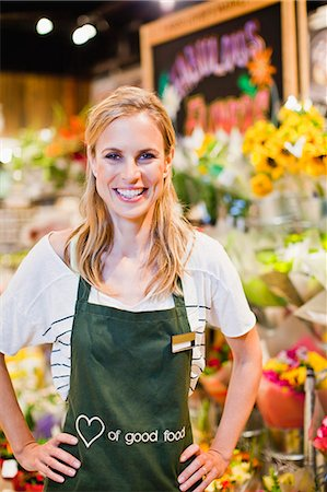 Grocer smiling in florist section Stock Photo - Premium Royalty-Free, Code: 649-06717201