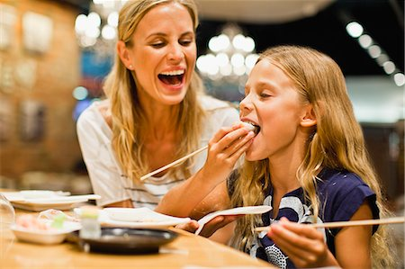 family table eating together - Mother and daughter using chopsticks Stock Photo - Premium Royalty-Free, Code: 649-06717215