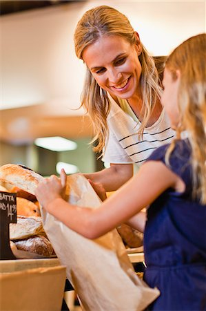 Mother and daughter in grocery store Stock Photo - Premium Royalty-Free, Code: 649-06717210