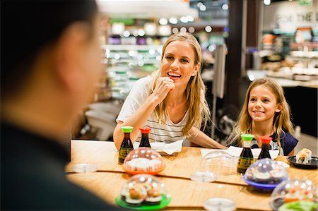 family table eating together - Mother and daughter eating at deli Stock Photo - Premium Royalty-Free, Code: 649-06717213