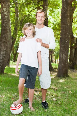 Father and son smiling in park Stock Photo - Premium Royalty-Free, Code: 649-06717243