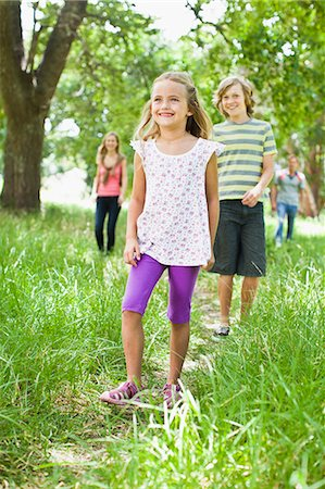 Children walking together in grass Stock Photo - Premium Royalty-Free, Code: 649-06717263