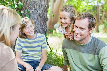 Family relaxing together in park Stock Photo - Premium Royalty-Free, Code: 649-06717271