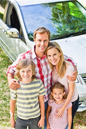 Family smiling together by car Stock Photo - Premium Royalty-Free, Code: 649-06717296