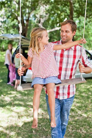 Father pushing daughter on swing Stock Photo - Premium Royalty-Free, Code: 649-06717298