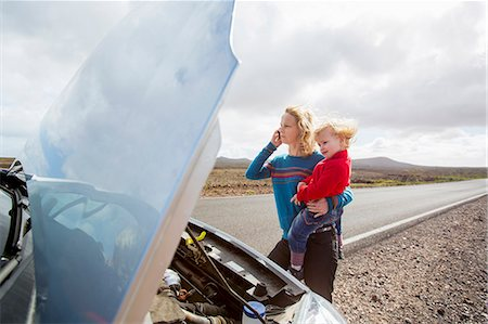 remote car - Mother and daughter with broken down car Stock Photo - Premium Royalty-Free, Code: 649-06717338