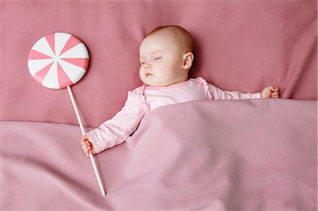 Baby girl sleeping in bed Stock Photo - Premium Royalty-Free, Code: 649-06717438